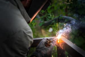 Welding the corner of a metal fence