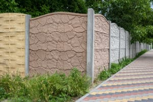 Multicolored concrete fence with various textures