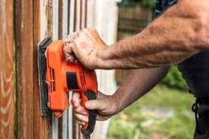 Sanding and repairing fence