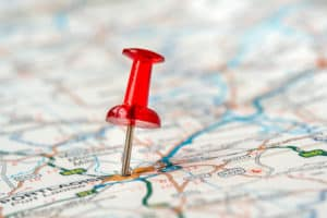 Map with red push pin