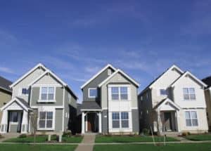 Three same styled gray houses