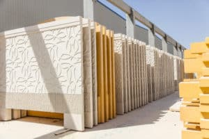 Collection of textured precast wall pieces in a line