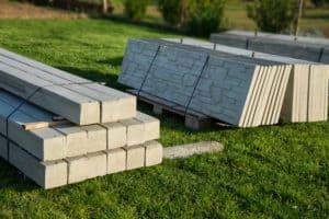 Gray precast wall materials sitting on grass
