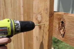 Wooden fence being repaired