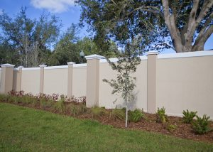Permacast precast concrete fence with landscaping