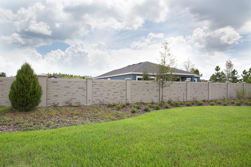 Permacast precast concrete fence surrounding housing development