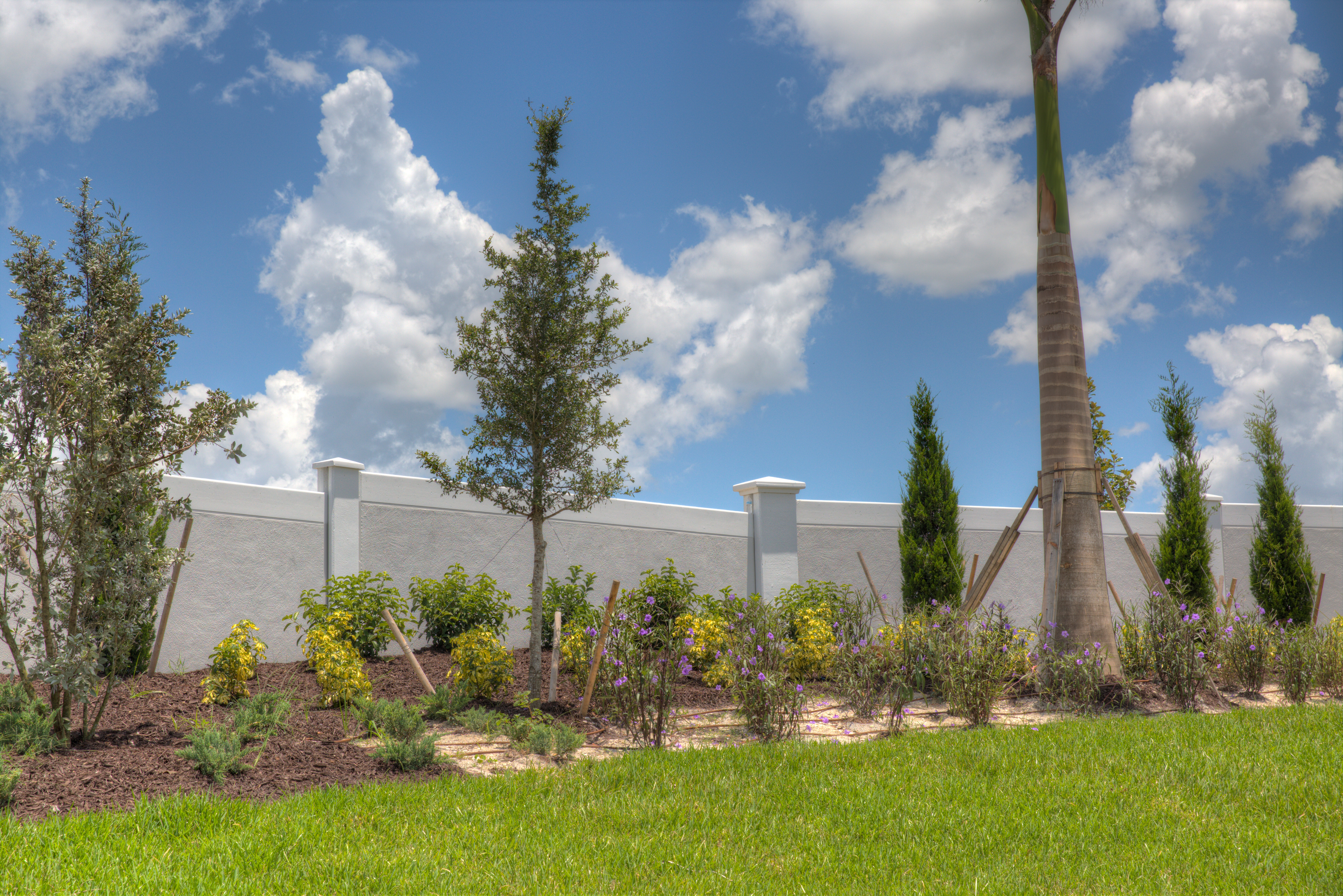 Permacast precast concrete fence with landscaping - Permawall