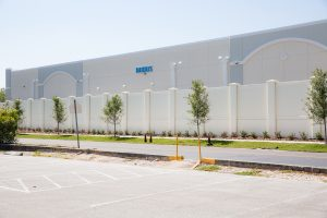 Precast concrete retaining wall by Permacast - precast concrete fencing