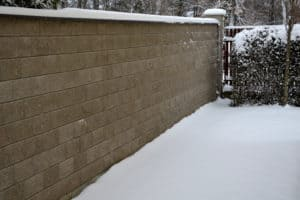 Snow covered concrete wall