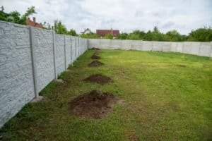 Permacast fence surrounding grassy property